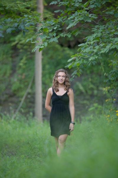 Senior image taken in green field in Northeast Ohio.